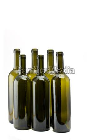 six empty wine bottles isolated