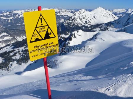 danger signposts winter sports attention ski