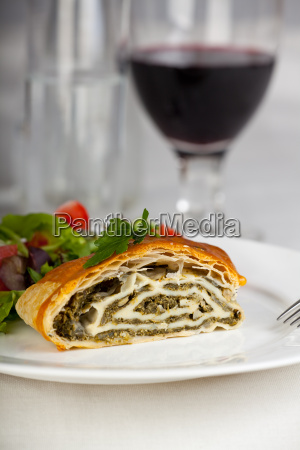 spinach strudel with salad and red