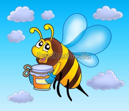 flying bee holding honey