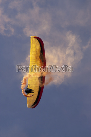 para glider with trail smoke