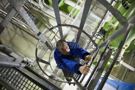 engineer climbing ladder