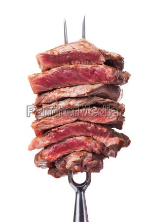 scheiben steak auf eine fleisch gabel