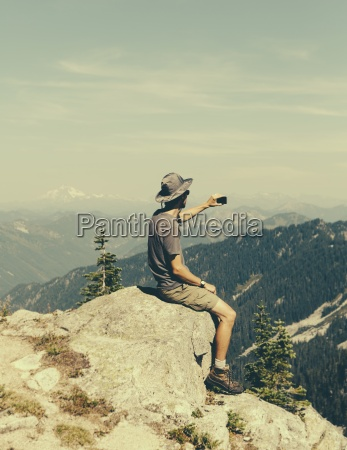 a hiker on a mountain summit