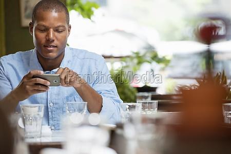 a man sitting in a city