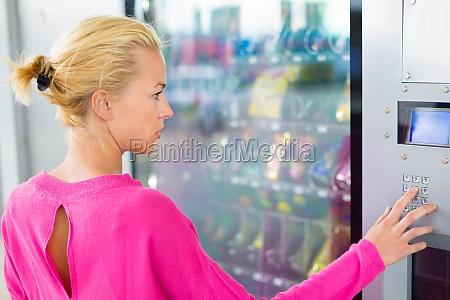 lady using a modern vending