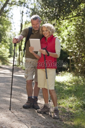 a mature couple out walking on