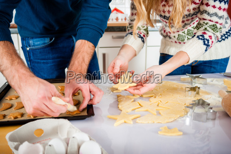 couple baking in the kitchen cookies