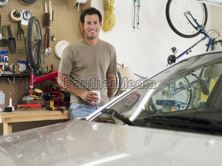 man repairing bicycle on workbench in