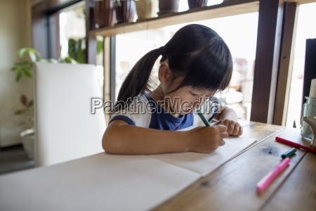 girl with pigtails sitting at a