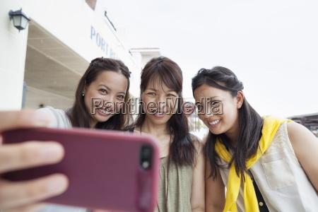 three women taking a selfie
