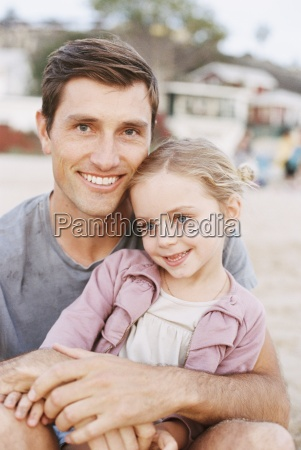 young girl sitting on her fathers