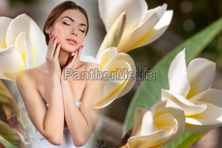 beautiful girl with white frangipani flowers