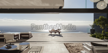 woman sunbathing on lounge chair at