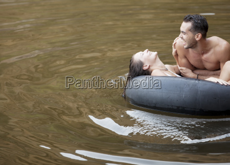 couple playing in inner tube on