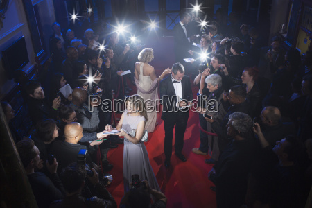well dressed celebrities signing autographs on
