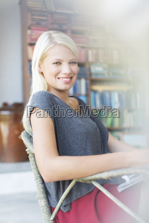 woman smiling in armchair
