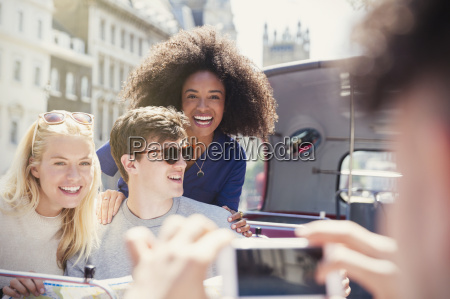 enthusiastic friends being photographed on double