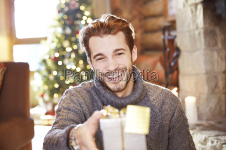 man offering gifts on christmas