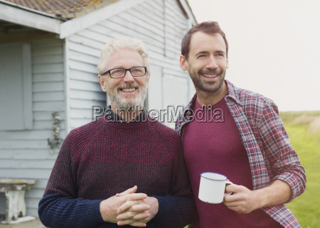 portrait smiling father and son drinking