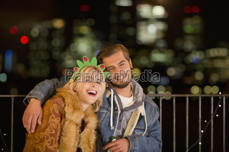 portrait smiling young couple enjoying nighttime