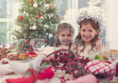 portrait smiling girls at christmas table