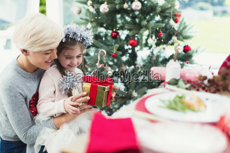 smiling mother and daughter with christmas