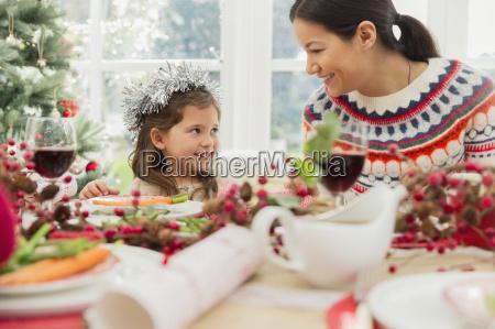 mother and daughter enjoying christmas dinner
