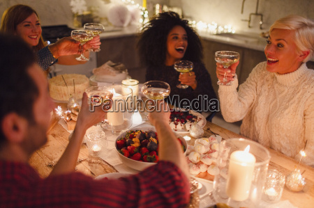 enthusiastic friends toasting champagne glasses at