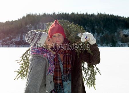 couple with christmas tree