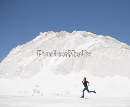 man running in front of white