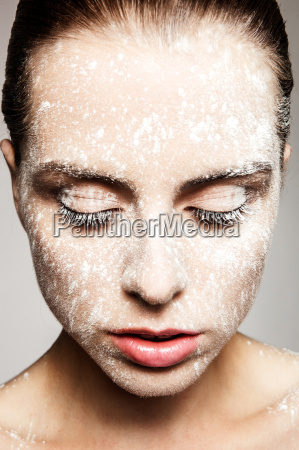 model with powder on face