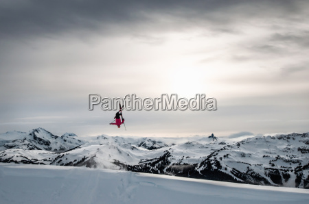 skier doing backflip on natural wind