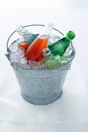 soda bottles in bucket of ice