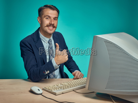 portrait of cheerful young businessman sitting