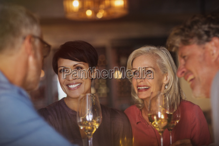 couples drinking white wine and talking