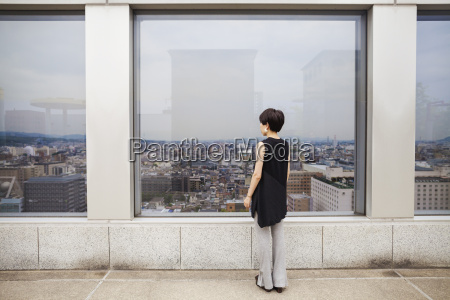 a woman standing looking over a