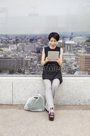 woman using a digital tablet with