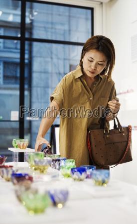 customer in a shop selling edo