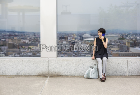 a, woman, seated, by, a, window - 20201311