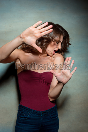 the, young, woman's, portrait, with, frightened - 20225337