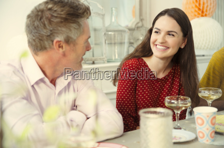 smiling couple talking and drinking champagne