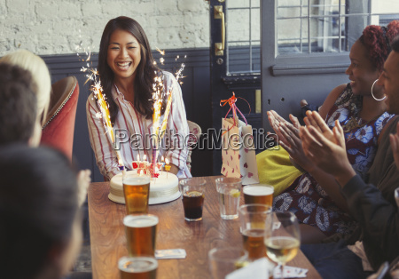 friends clapping for happy woman with