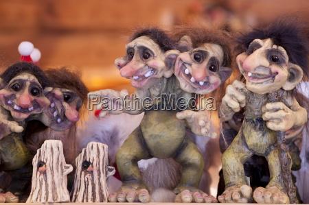 traditional trolls on display in tromso