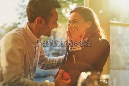 boyfriend proposing to surprised happy girlfriend