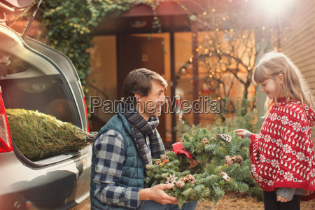 father and daughter with christmas wreath