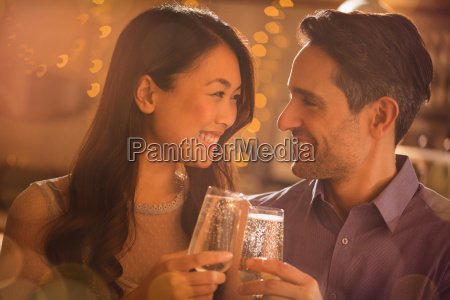 couple toasting champagne flutes