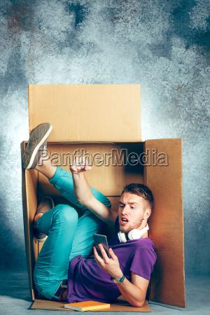 introvert concept man sitting inside box