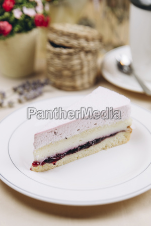 slice of blackcurrant cheesecake on plate